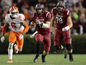 South Carolina quarterback Jake Bentley is seen here rushing the ball against the Clemson Tigers (Getty Images)