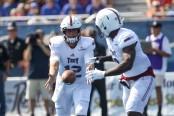 Troy Trojans quarterback Brandon Silvers passes the ball to Jamarius Henderson (Getty Images)