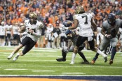 Wake Forest quarterback John Wolford carries the ball for a touchdown against the Syracuse Orange (Getty Images)