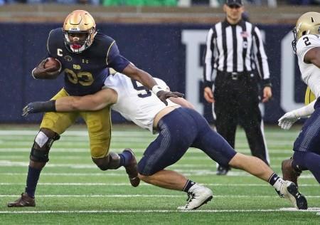 Notre Dame Fighting Irish running back Josh Adams rushing the ball against the Navy Midshipmen in November 2017 (Getty Images)