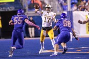 Wyoming Cowboys quarterback Josh Allen throwing a pass against the Boise State Broncos at Albertson's Stadium in October (Getty Images)