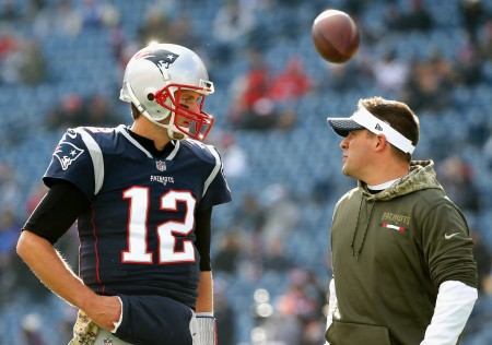 Josh McDaniels and Tom Brady talking prior to a game (Getty Images)