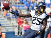West Virginia running back Justin Crawford after scoring a touchdown (Getty Images)