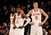 New York Knicks players Tim Hardaway Jr., Kristaps Porziņģis, and rookie Frank Ntilikina during the fourth quarter against the Cleveland Cavaliers in November 2017 (Getty Images)