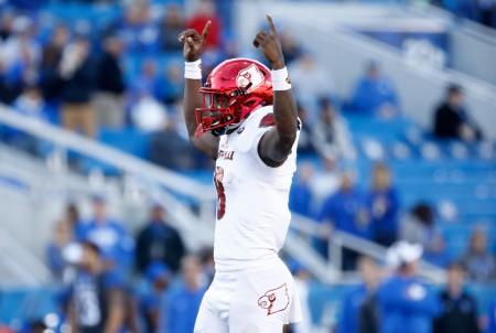 Louisville Cardinals quarterback Lamar Jackson celebrates a touchdown against the Kentucky Wildcats (Getty Images)