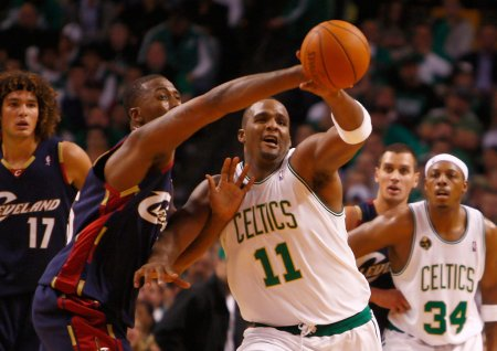 Cleveland Cavaliers' Lorenzen Wright deflects a pass intended for Boston Celtics' Glen