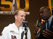 Marshall Faulk, a retired running back, seen here interviewing Peyton Manning at during the Super Bowl 50 media day (Getty Images)