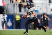 UCF Knights quarterback Mckenzie Milton runs the option in the second quarter of the American Athletic Conference Championship game against the Memphis Tigers (Getty Images)