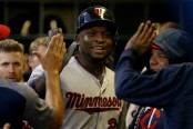 Minnesota Twins third baseman Miguel Sanó celebrates with his teammates after scoring a run against the Milwaukee Brewers (Getty Images)
