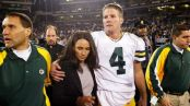 Green Bay Packers quarterback Brett Favre walking off the field with his wife Deanna following the win over the Oakland Raiders one day after his father's death (Getty Images)