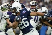 Penn State Nittany Lions running back Saquon Barkley rushing the ball against the Washington Huskies (Getty Images)