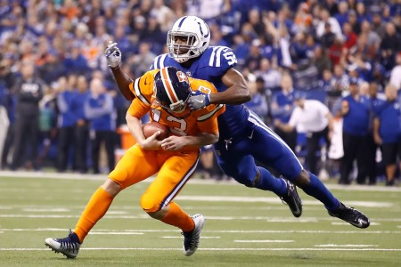 Denver Broncos quarterback Trevor Siemian being sacked by Indianapolis Colts linebacker Barkevious Mingo. (Getty Images)