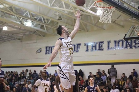 Former Lion Bobby Brackett going to the basket against John Jay College (Photo by TCNJ Sports Information)