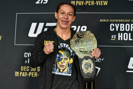 """UFC Featherweight Cristiane """"Cris Cyborg"""" Justino with her belt at a news conference following her win over Holly Holm (Getty Images)"""