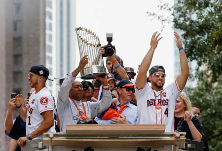Sylvestor Turner, Houston mayor, lifts up the World Series Championship trophy, as George Springer and Carlos Correa look on in the Astros Victory Parade (Getty Images)