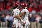 Alabama quarterbacks Jalen Hurts and Tua Tagovailoa in the College Football Playoff National Championship game (Getty Images)
