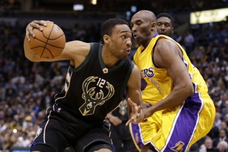 Jabari Parker going to the basket against Kobe Bryant (Getty Images)