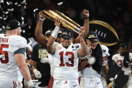 Tua Tagovailoa holds the College Football Playoff National Championship trophy after guiding the Alabama Crimson Tide to an historic comeback win over the Georgia Bulldogs (Getty Images)