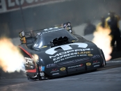 Matt Hagan is seen here making a pass on Saturday during qualifying at Auto Club Raceway at Pomona in Pomona, California (Photo by the NHRA)