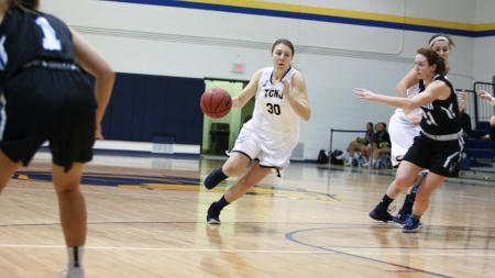 Samantha Famulare is seen here going to the basket against the Stockton Ospreys (Photo by Jon Lambert/TCNJ Sports Information Department)