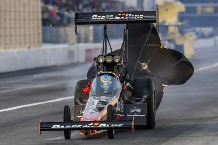 Great Clips/Parts Plus Top Fuel Dragster pilot Clay Millican sets a national record in Pomona (Photo by the NHRA)