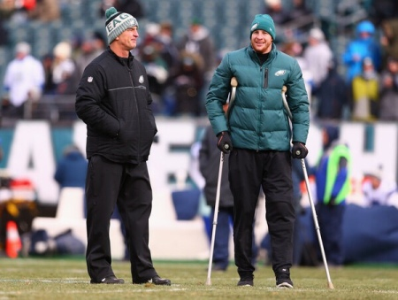Frank Reich is seen here as the Philadelphia Eagles offensive coordinator talking to an injured Carson Wentz (Getty Images)