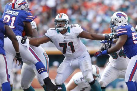 Jonathan Martin is seen here as a member of the Miami Dolphins and blocking against the Buffalo Bills (Getty Images)