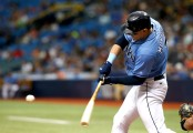 Logan Morrison is seen here as a member of the Tampa Bay Rays hitting the ball (Getty Images)
