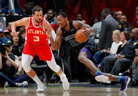 Marco Belinelli is seen here as a member of the Atlanta Hawks defending against Charlotte Hornets' Treveon Graham (Getty Images)