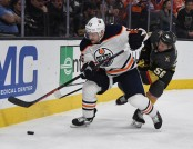 Mark Letestu is seen here as a member of the Edmonton Oilers skating with the puck as Vegas Golden Knights' Erik Haula attempts to get the puck (Getty Images)