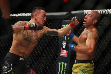 Max Holloway punching Jose Aldo (Getty Images)