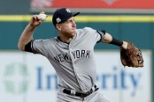 Former New York Yankees third baseman Todd Frazier is seen here attempting to throw out a base runner (Getty Images)