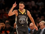 Stephen Curry is seen here celebrating a three pointer against the New York Knicks (Getty Images)