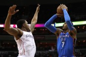 Oklahoma City Thunder forward Carmelo Anthony takes a shot over Washington Wizards guard Bradley Beal (Getty Images)