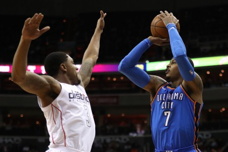 Oklahoma City Thunder forward Carmelo Anthony takes a shot over Washington Wizards guard Bradley Beal (Getty Images)