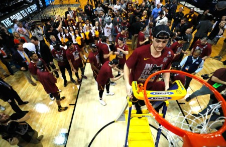 Clayton Custer is seen here cutting down the net after No. 11 seed Loyola-Chicago advanced to their second Final Four in program history (Getty Images)