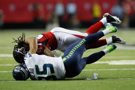 Former Seattle Seahawks cornerback DeShawn Shead tackling Atlanta Falcons running back Devonta Freeman at the Georgia Dome on January 14th, 2017 (Getty Images)