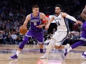Memphis Grizzlies guard Dillon Brooks is seen here attempting to guard Sacramento Kings guard Bogdan Bogdanović (Getty Images)