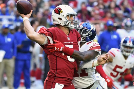 Drew Stanton is seen here as a member of the Arizona Cardinals attempting to get off a pass as Dominique Rodgers-Cromartie attempts to sack him (Getty Images)