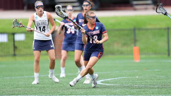 Courtney Patterson is seen here with the ball against the Lions (Photo by Gettysburg College/Andres Alonso)