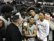 Roselle Catholic celebrating with the TOC trophy after the win (Photo by the NJSIAA)