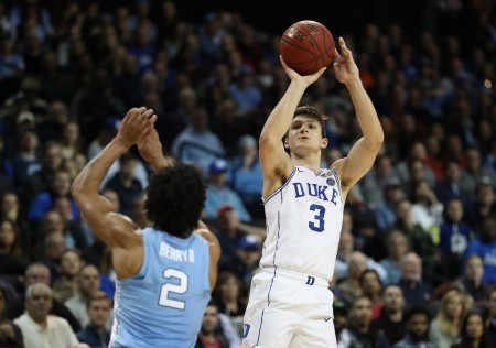 Grayson Allen is seen here attempting a shot over Joel Berry II (Getty Images)