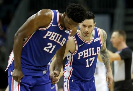 Joel Embiid is seen here talking to teammate J.J. Redick (Getty Images)