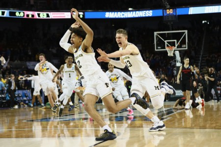 Jordan Poole is seen here celebrating his game-winning three-pointer to help the Michigan Wolverines advance to the Sweet Sixteen (Getty Images)
