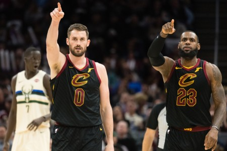 Kevin Love is seen here, along with LeBron James, celebrating a teammates basket against the Milwaukee Bucks (Getty Images)