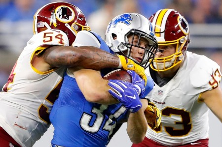 Washington Redskins players Trent Murphy and Mason Foster tackle Detroit Lions running back Zach Zenner (Getty Images)