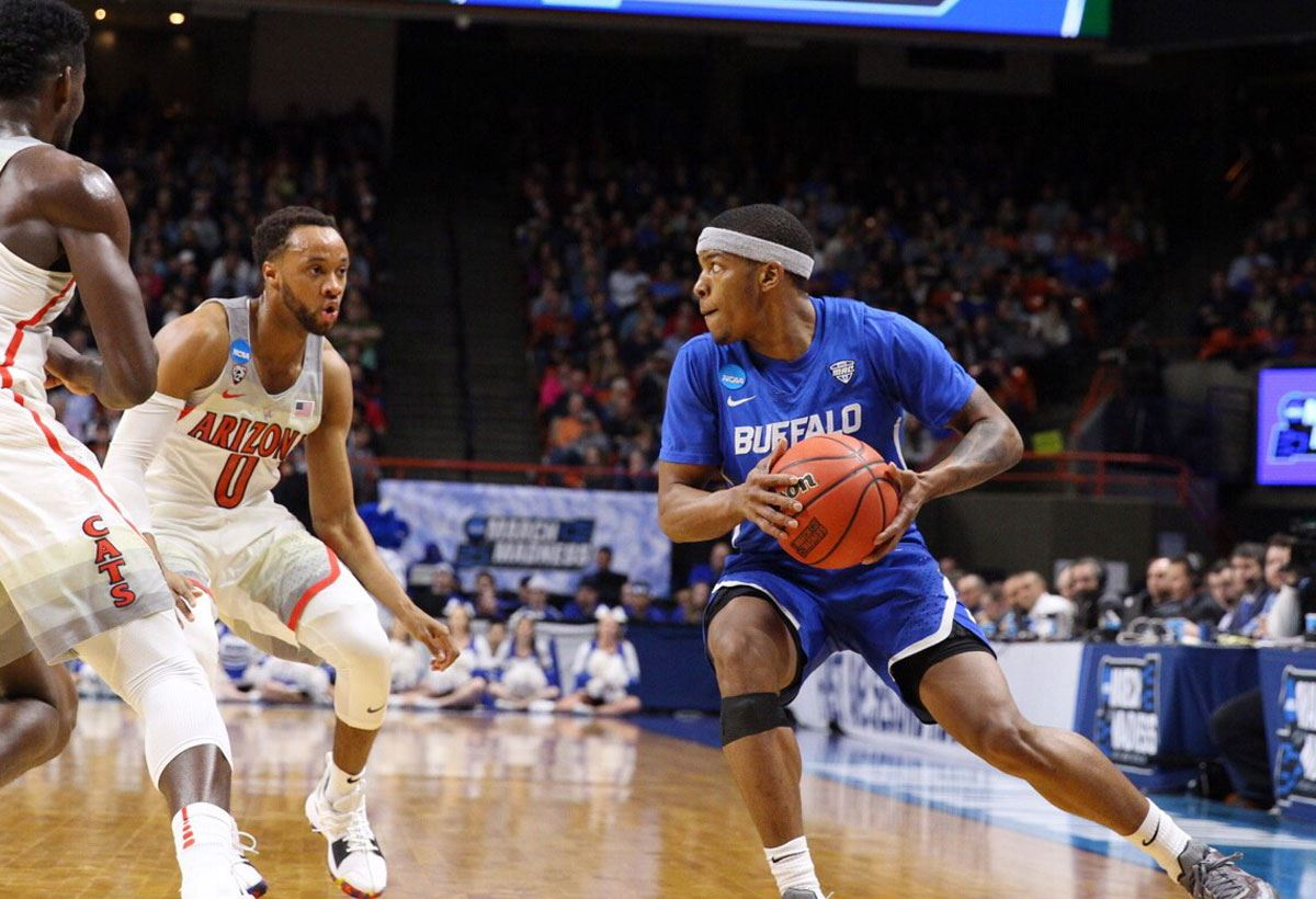Guard Wes Clark has the ball in the 2018 NCAA Men's Basketball Tournament against the Arizona Wildcats