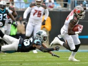 Daryl Worley is seen here as a member of the Carolina Panthers when he was attempting to tackle Tampa Bay Buccaneers receiver Chris Godwin (Getty Images)