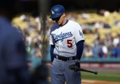 Corey Seager is seen here walking off the field after an at-bat (Getty Images)