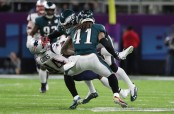 New England Patriots wide receiver Brandin Cooks is seen here taking a hit by Eagles safeties Malcolm Jenkins and Rodney McLeod in Super Bowl LII (Getty Images)